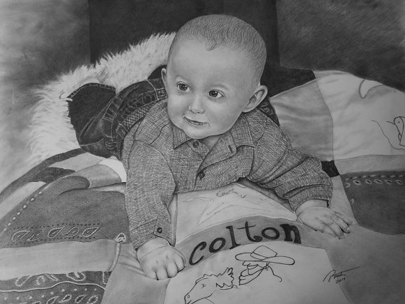 Clarence Pencileman Baby on Quilt